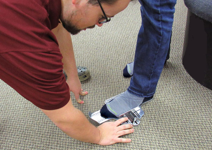 Proper Foot Measuring Being Done by a Trained Professional at Family Footwear Center
