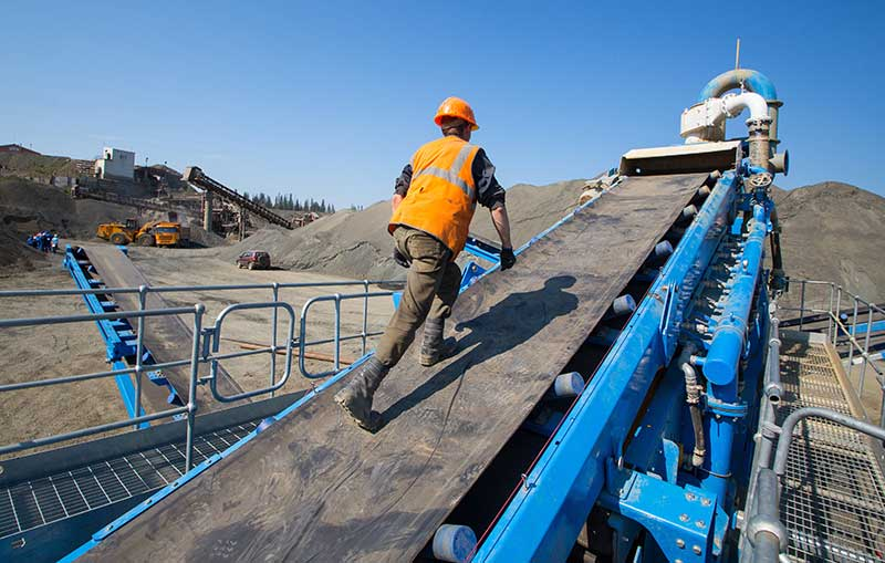 Mining Sites require work boots with traction outsoles for walking on conveyor belts and slippery metal-grated stairs and walkways