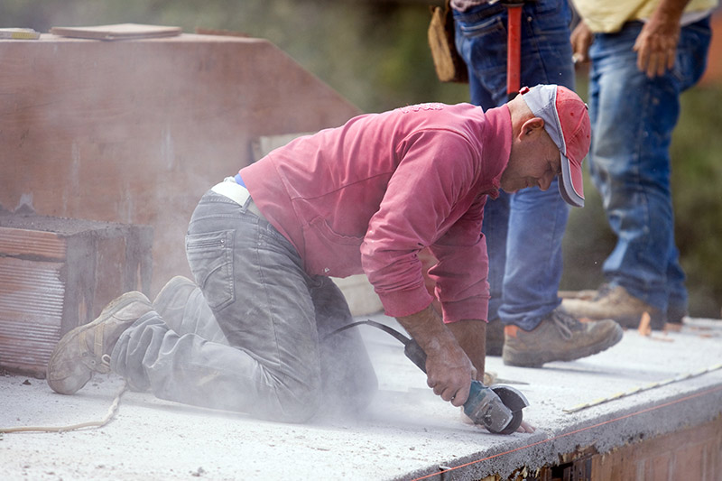 Brick Laying Work can quickly chew up the leather on the toes of Steel Toe Boots